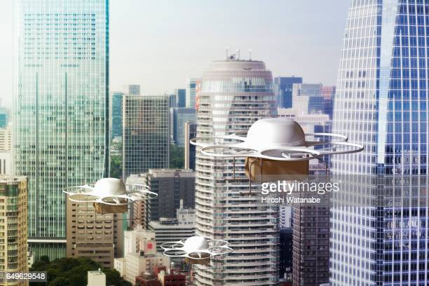 Three delivery drones flying above the city