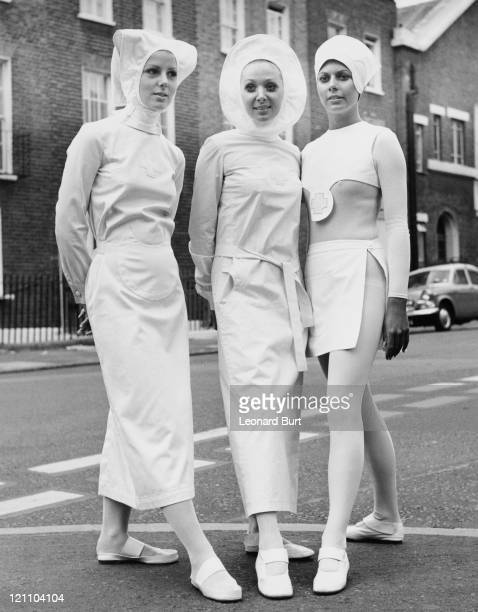 Three designs for British nurses by couturier Pierre Cardin on show outside Seymour Hall in London 26th October 1970 From left to right Sally Over...