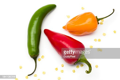 Three different colored and shaped peppers isolated on white