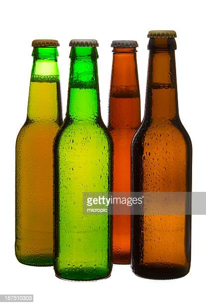 Three different colored beer bottles and caps