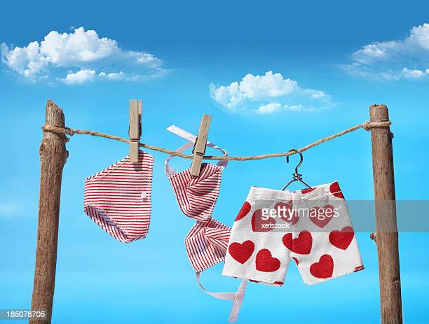 Three different pieces of laundry on the clothes line