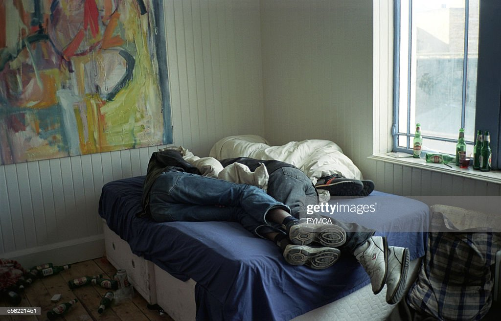 shoes bedroom three drunk teenagers asleep in clothes and shoes on a bed at