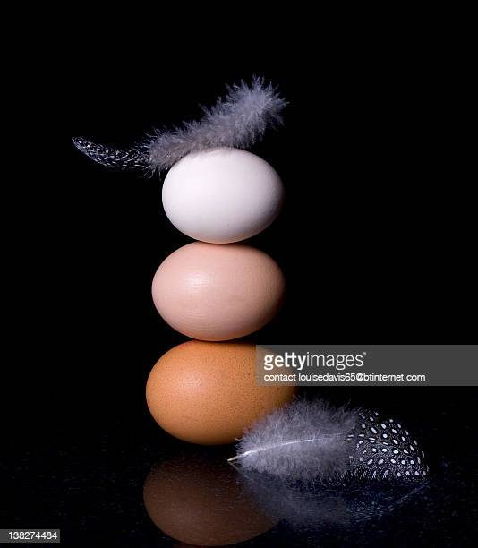 Three eggs and couple of feathers