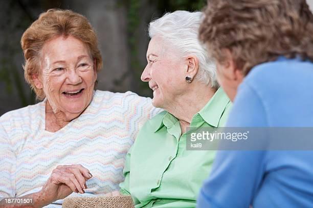 Three elderly women talking