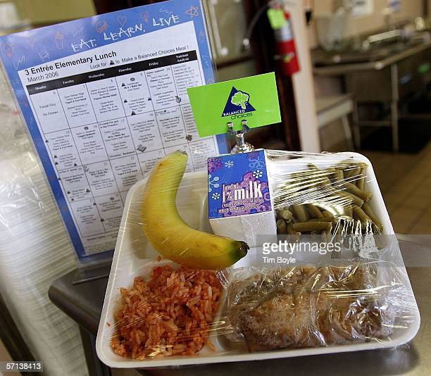 A three entree elementary lunch lies on display in the Nettelhorst Elementary School lunchroom March 20 2006 in Chicago Illinois US Senator Dick...