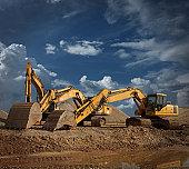 Three Excavators at Construction Site
