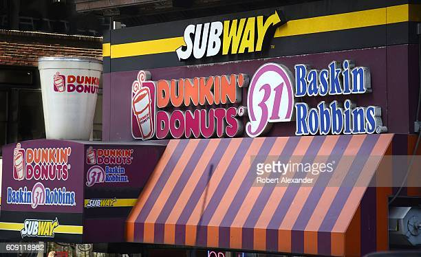 Three fastfood franchises Dunkin' Donuts Baskin Robbins and Subway operate sidebyside under one roof in New York City Dunkin' Donuts is owned by...