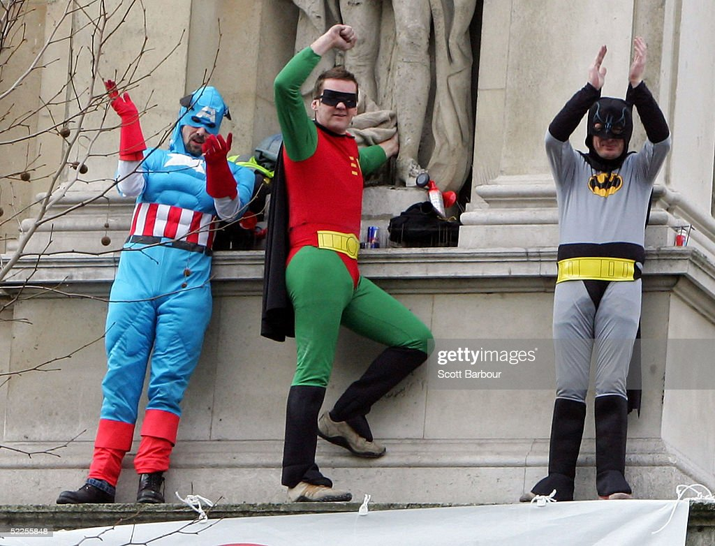 Three Fathers 4 Justice campaigners protest on a ledge on the corner of Downing Street on February 28, 2005 in London, England. The three, dressed as Batman, Robin and Captain America reached the wall of the Foreign Office building above the heavy duty security gates which protect Britain' Prime Minister Tony Blair's official residence of Downing Street from possible terrorist attacks.