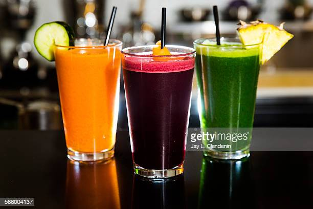 Three favorite juice drinks made in downtown Los Angeles at Sustain Juicery for $7 Volcanoe with orange carrot and ginger juices with cayenne an ABCG...