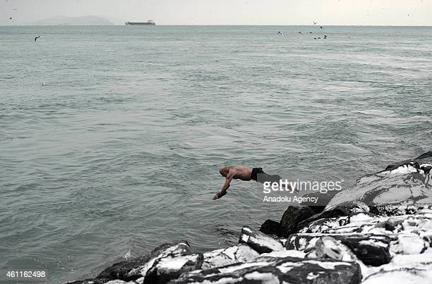 Three fellows who call themselves as 'Sarayburnu Conquerors' brave the icy sea for swimming in Sarayburnu district of Istanbul Turkey on January 08...