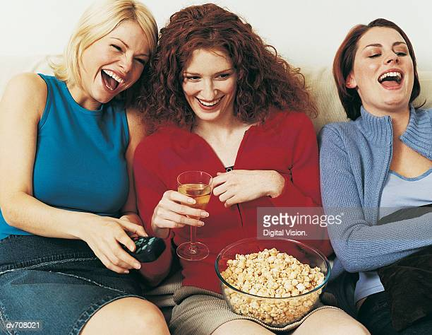 Three Female Friends Relaxing in Front of the Television