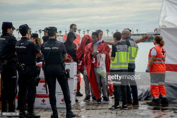 Three female migrants who just being rescued by the Spanish Maritime after arriving on a Spanish coast guard vessel into the southern Spanish port of...