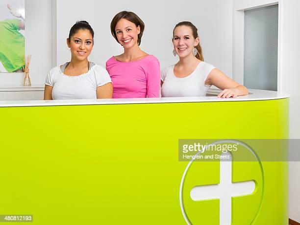 Three female receptionists at desk