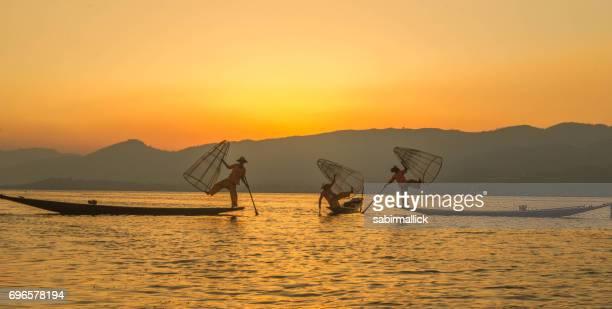 Three fisherman at Inle Lake, Myanmar.