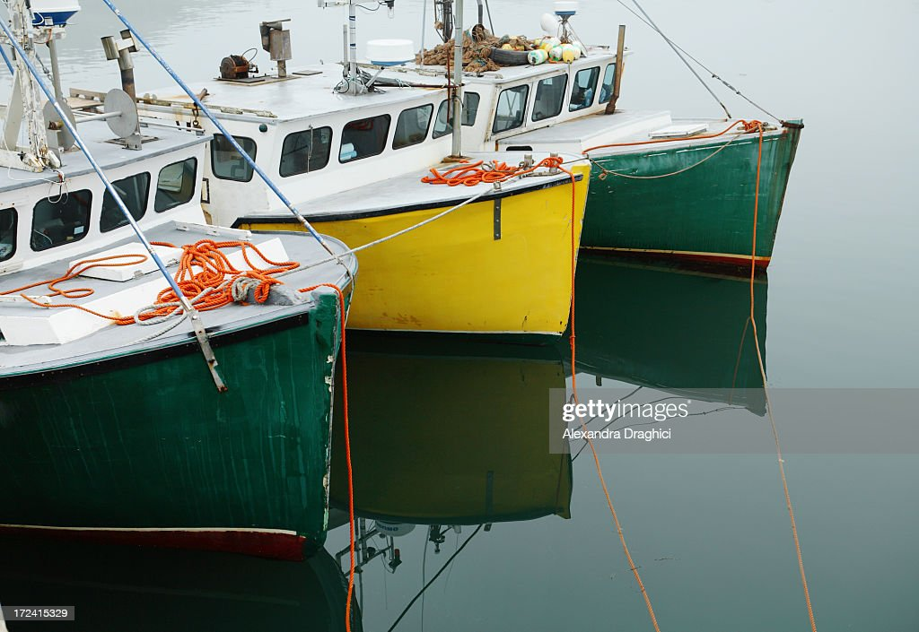 Three fishing boats in a row stock photo getty images for Fishing row boats