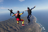 Three formation skydivers free falling
