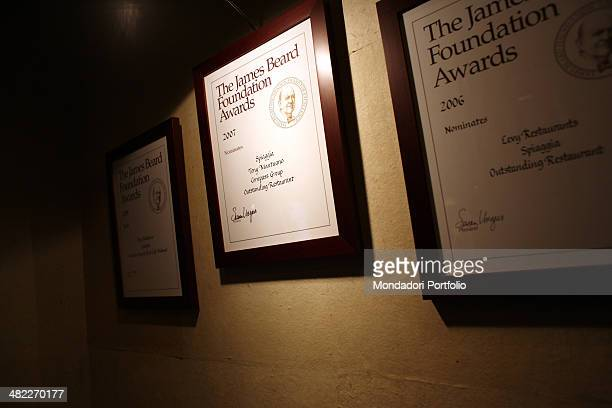 Three framed accolades hanging from a wall at the restaurant Spiaggia achieved by the chef Toni Mantuano in 2005 2006 and 2007 those are The James...