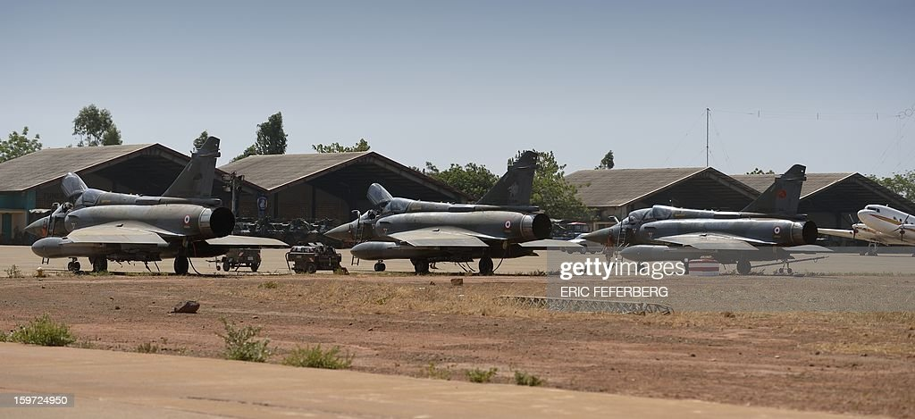 Three French Mirage 2000 planes remain on the flight path at the Malian army 101 airbase where French troops are stationed, on January 19, 2013, near Bamako. Meanwhile West African leaders sought urgent UN aid for a regional force to fight Islamists in Mali as President Francois Hollande said French troops would remain as long as needed to stamp out 'terrorism'.
