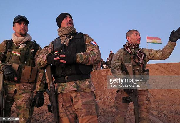 Three French volunteers in the fight against the Islamic State group Fred Pascal and Kim watch a small surveillance drone returning from a...