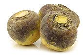 three fresh turnips(brassica rapa rapa) on a white background