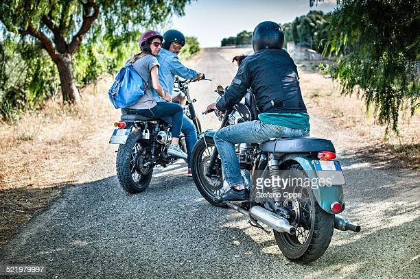Three friends and one dog on motorcycles, Cagliari, Sardinia, Italy