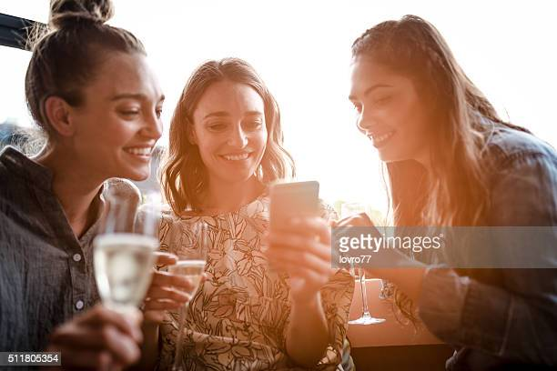 Three friends celebrating