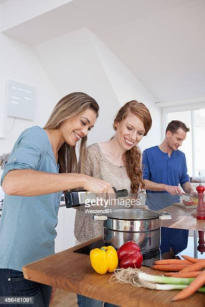 Three friends cooking together