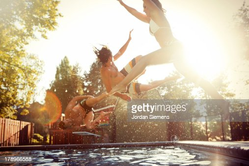 Three friends enjoying a day at the pool. : Foto stock