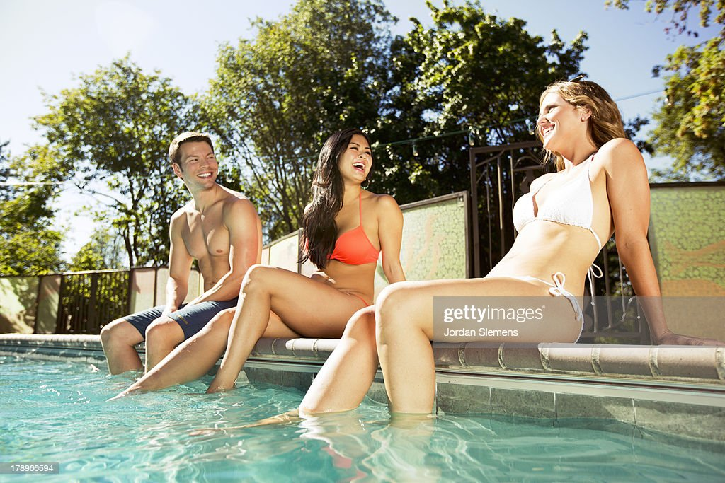 Three friends enjoying a day at the pool. : Stock Photo