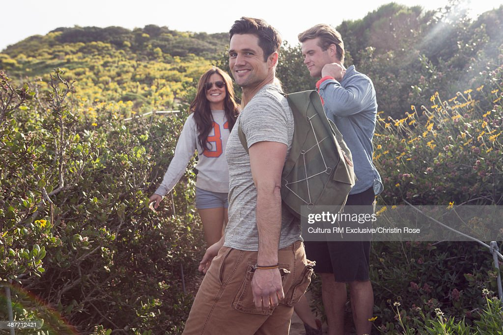 Three friends enjoying walk on vacation : Stock Photo