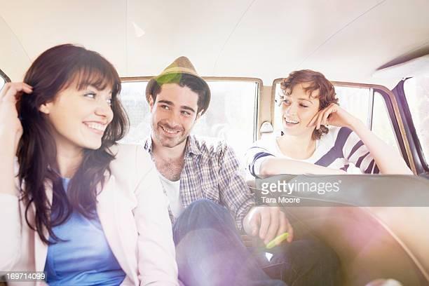 three friends having fun in vintage car