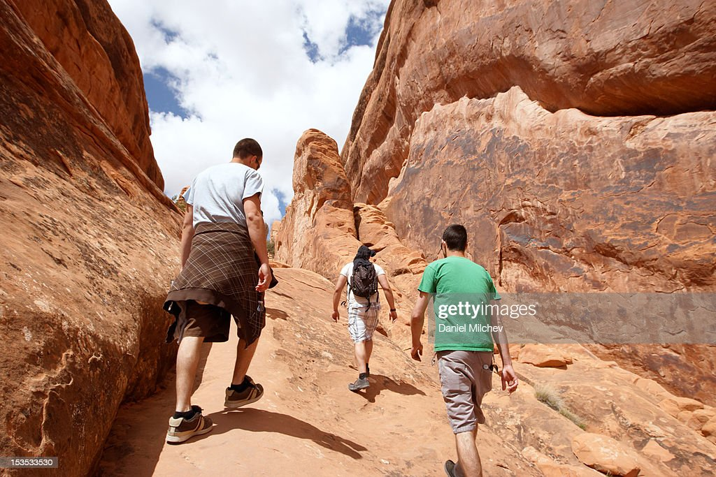 Three friends hiking in Moab. : Stock Photo