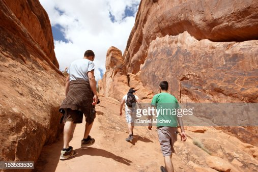 Three friends hiking in Moab. : Photo