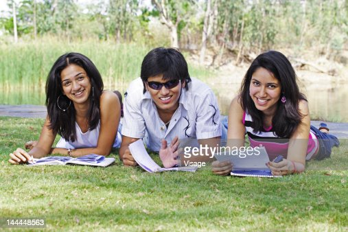 Three friends in a park : Stock Photo