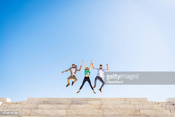 Three Friends Jumping