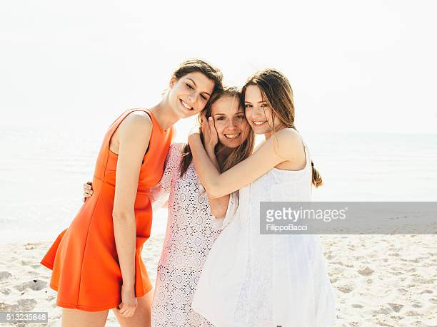 Three Friends On The Beach Together