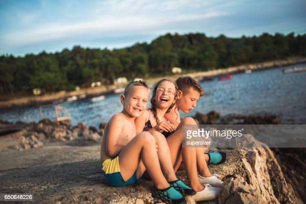 Three friends on the rocky beach