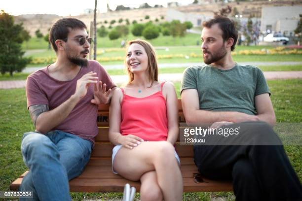 Three Friends Talking On The Bench
