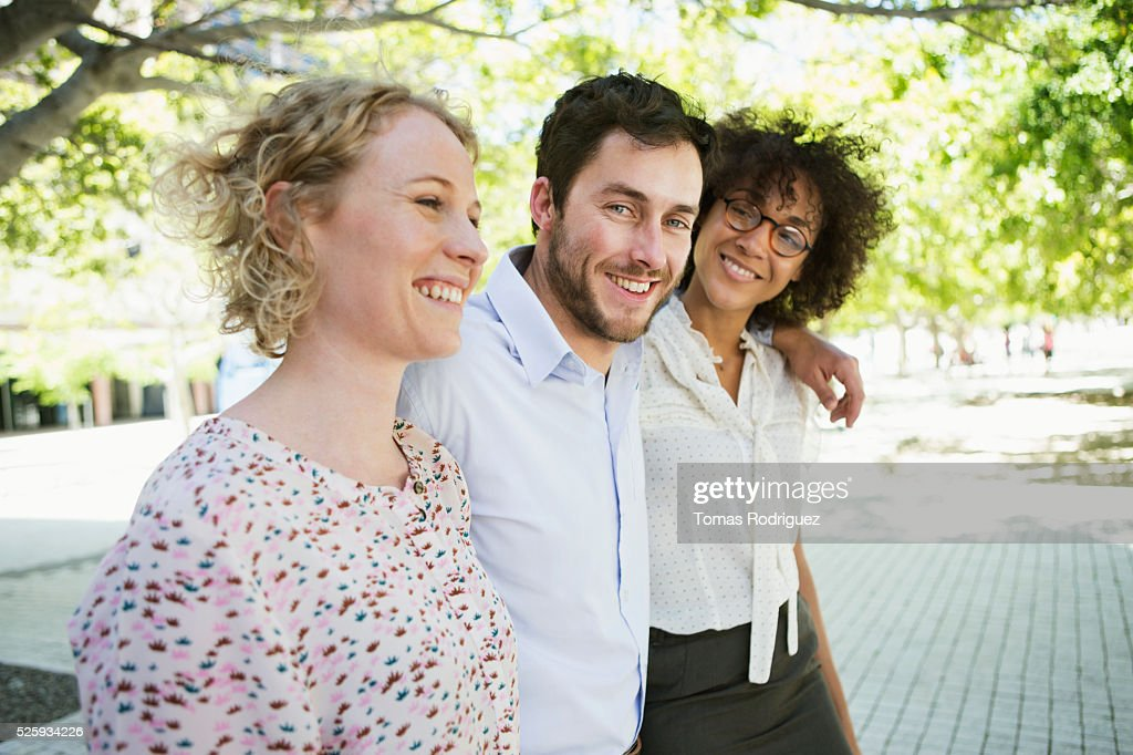 Three friends walking in park : Stock Photo