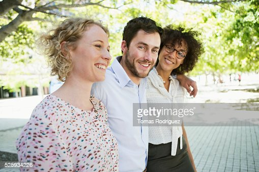 Three friends walking in park : Stockfoto