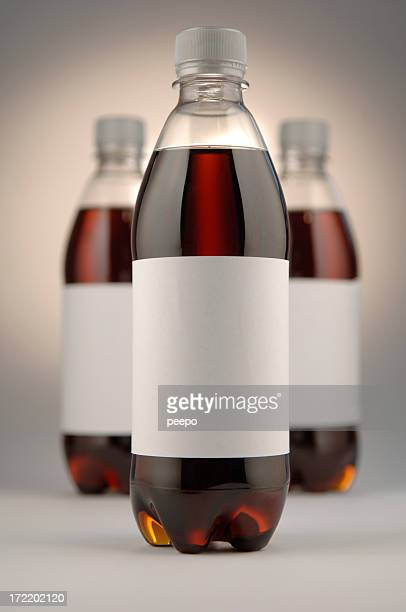 Three Full Cola Bottles With Blank Labels