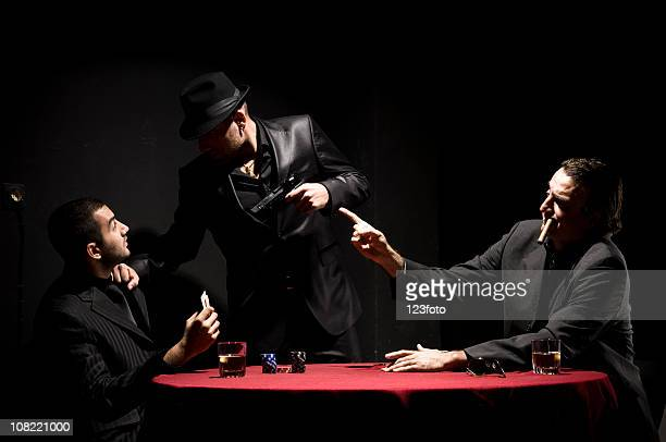 Three Gangster Men Playing Cards While Smoking and Drinking