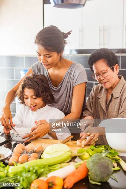 Three Generation Asian Family Cooking Healthy Food Together