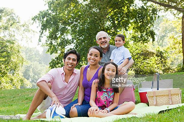 Three generation family at picnic in park, portrait