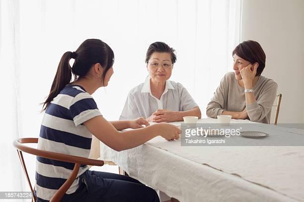 Three generation family at table