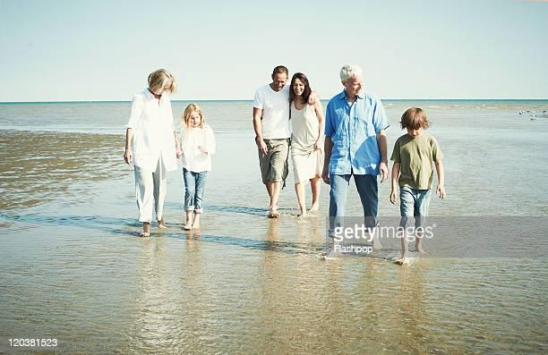 Three generation family enjoying day at the beach