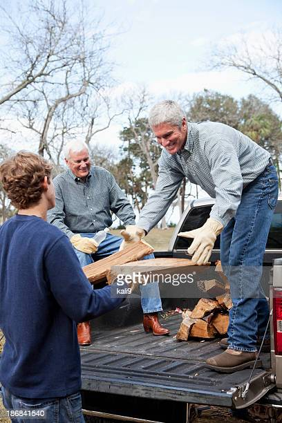 Three generation family gathering firewood