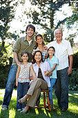 Three generation family including children (7-11) in garden, portrait
