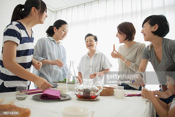 Three generation family laughing at mealtime