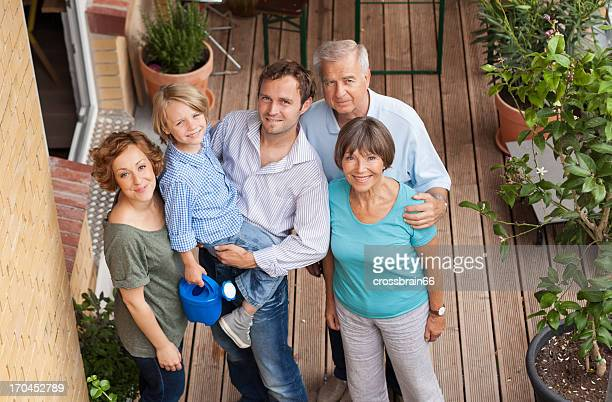 three generation family on balcony